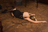 Lifeless woman in a luxurious lingerie lying on the floor — Stock Photo