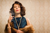Retro woman portrait with cigarette — Stock Photo