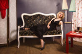 Sensual blonde lady in black — Stock Photo