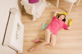Crime scene simulation. Dead girl lying on the floor — Stock Photo