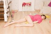 Crime scene simulation. Dead girl lying on the floor — Stock Photo