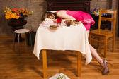 Crime scene simulation. Poisoned girl lying on the table — Stock Photo