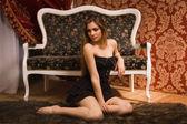 Sensual young lady in black — Foto de Stock
