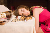 Crime scene simulation. Poisoned girl lying on the table — Stock Photo