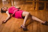 Crime scene simulation. Poisoned girl lying on the floor — Stock Photo