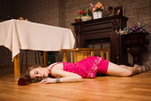 Crime scene simulation. Poisoned girl lying on the floor — Stock Photo