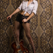 Rock babe with electric guitar — Stock Photo #44623163