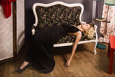 Lifeless woman in a luxurious interior — Stock Photo