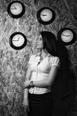 Office girl on a background of a wall clock — Foto de Stock