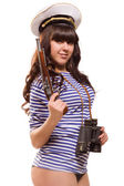 Beautiful woman sailor in pinup style with pistol — Photo