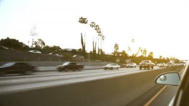 Oncoming traffic on american highway at sunset — Stockvideo