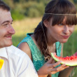 Young couple eating watermelon — Stock Photo