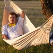 Young man swinging in hammock — Stock Photo