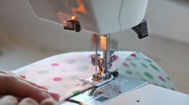 Closeup view of girl sewing on machine — Стоковое видео