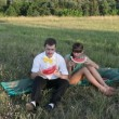 Young couple eating watermelon at picnic, closeup view — Stock Video