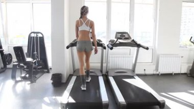 Athletic woman running on the track in gym — Stock Video #13284152