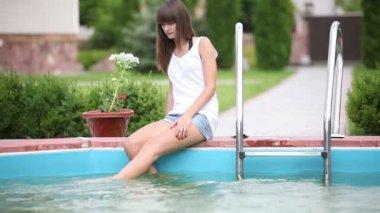Pretty girl near swimming pool — Stock Video