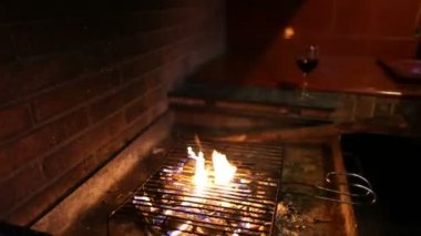 Barbecue with fire and glass of wine — Stock Video