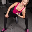 Athletic young woman with dumbbells - Stock Photo