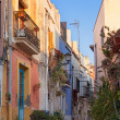 Old street with multicolored houses — Stock Photo