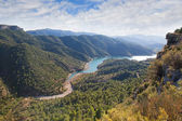 Valley with the river and cloudy sky — Stock Photo