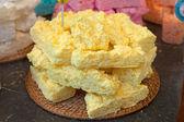 Yellow meringue cakes in pile — Stock Photo