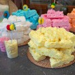 Yellow and multicolor meringue cakes in pile — Stock Photo