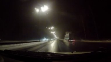 Car moving on the night road through snowstorm — Stock Video
