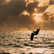 Kite surfer jumping from the water — Stock Photo