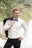 Young groom near the pool — Stock Photo