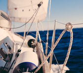 Knot on rope and sailboat crop — Stock Photo