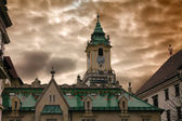 Town hall and dramatic cloudy sky — Stock Photo