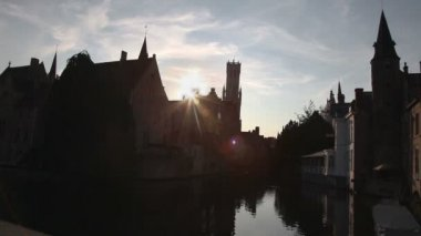 Houses and channel in Bruges, Belgium during sunset. Timelapse — Stock Video