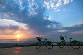 Two bicycles at sunset — Stok fotoğraf