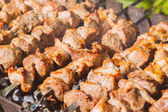 Shashlyk (kebab) grilling on the bbq, vintage style — Stock Photo
