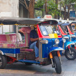 Line of tuktuks with driver on Bangkok street — Stock Photo #8935309