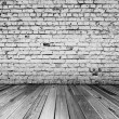 Bricks in black and white room — Stock Photo