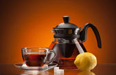 Tea cup and pot — Stockfoto