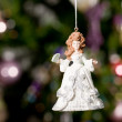 Christmas doll with tree and lights on b — Stock Photo #1272764