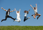 Young jump across sky — Stock Photo