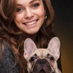 Beautiful girl with french bulldog puppy — Stock Photo #31132295