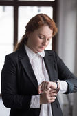 Business woman check time in office — Stock Photo