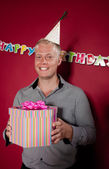 Birthday boy with gift — Stock Photo