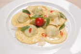 Ravioli with red chily pepper and sweet basil — Stock Photo