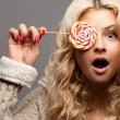 Young woman with candy — Stock Photo #13929060