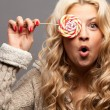 Young woman with candy — Stock Photo #13929158