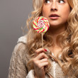 Young woman with candy - Stock Photo