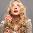 Young woman with candy — Stock Photo