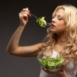 Happy healthy woman with salad — Stock Photo #13930839