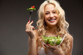 Happy healthy woman with salad — Stock Photo